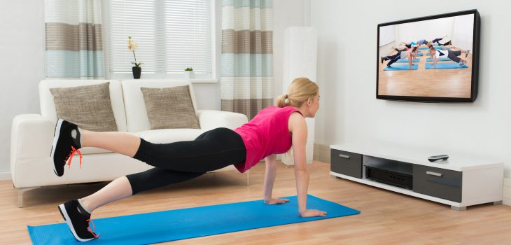 Woman doing pilates in her living room.